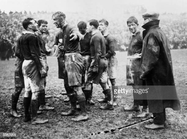 Players in a rugby match between Wales and Scotland at Cardiff at halftime Although history credits the invention of rugby to Webb Ellis at Rugby...