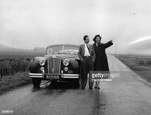 King Peter of Yugoslavia and Queen Alexandra in exile with their car near Paris where they have settled Original Publication Picture Post 7505...
