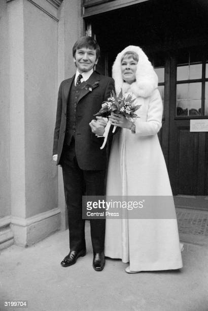 Royal Shakespeare Company players Judi Dench and Michael Williams after their wedding ceremony at St Mary's Catholic Church in Hampstead London