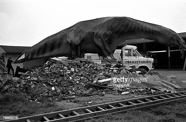 5th February A boy grabs the tail of a 45 foot long Cetiosaurus dinosaur which is made of tubular steel and covered with paper wire mesh and concrete...
