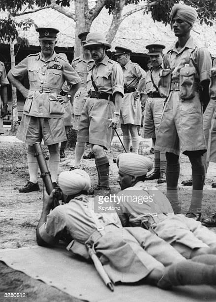 General Archibald Percival Wavell inspects a trench mortar section of a Dogra regiment during his visit to Singapore