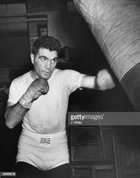 American lightheavyweight and Golden Gloves champion Joe Maxim training at Solomon's gym in London in preparation for his world title fight against...