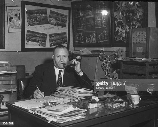 British boxing promoter Jack Solomons in his office