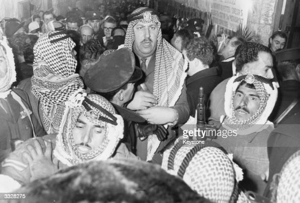 Jordanian soldiers holding back crowds during Pope Paul VI's visit to Jerusalem.