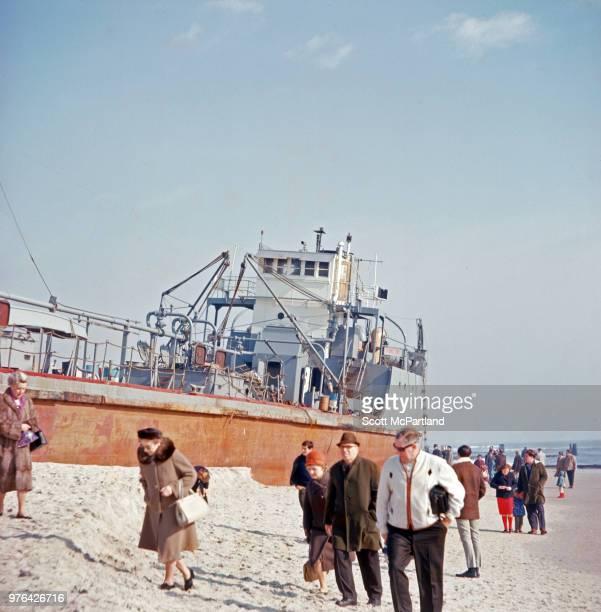 New York City - People walk around the Passaic Sun oil tanker, which ran aground on Rockaway Beach near the town of Belle Harbor, Queens.