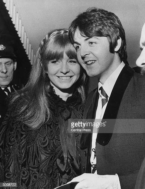 Beatle Paul McCartney and his girlfriend Jane Asher arrive at the London Pavilion for the premiere of 'Here We Go Round the Mulberry Bush'