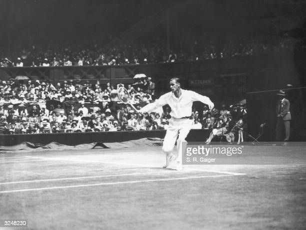 American tennis player William Tatem Tilden in action against Wilmer Allison also of the US during the men's singles final at Wimbledon Tilden...
