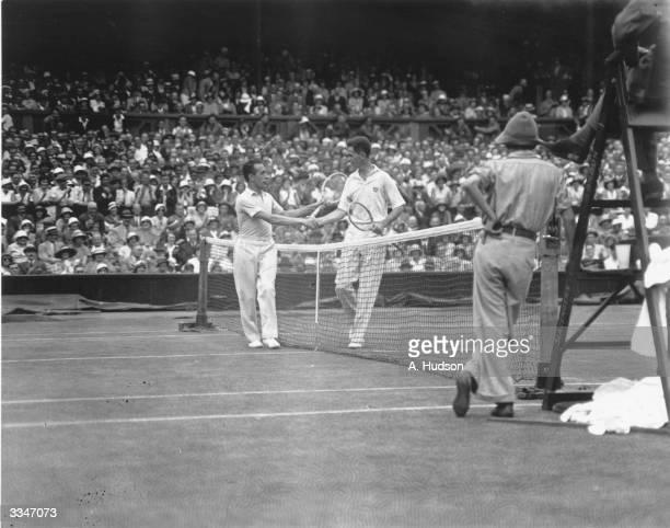 Henri Cochet congratulates Ellsworth Vines on winning their semifinal match at the All England Lawn Tennis Championships at Wimbledon