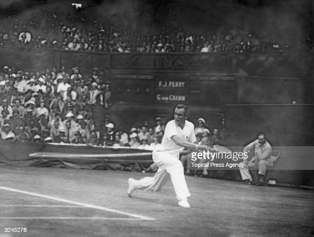 The finals of the men's singles championships at Wimbledon Fred Perry of Great Britain plays a winning match against Baron Gottfried Von Cramm of...