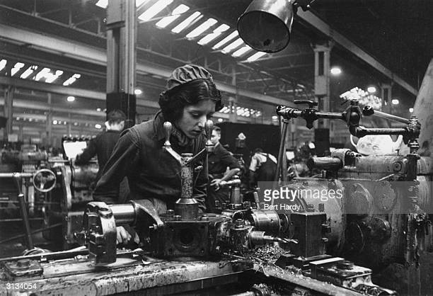 Female worker manufacturing guns in a munitions factory in Britain during World War II. Original Publication: Picture Post - 761 - They Make The Guns...