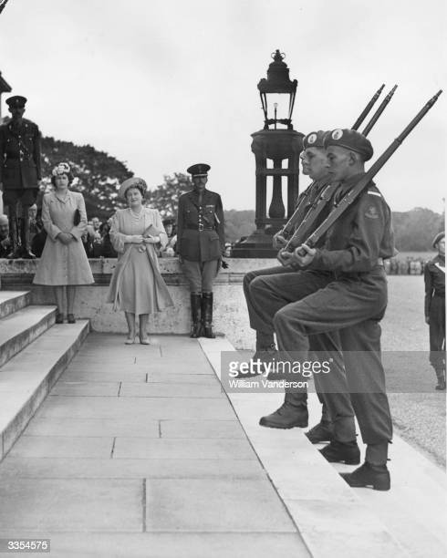 Queen Elizabeth The Queen Mother and Princess Elizabeth watching cadets performing a traditional march during their Passing Out Parade at the Royal...