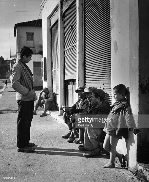 The villagers of Olympia in Greece sit and chew the fat Original Publication Picture Post 5953 Where The Olympic Games Started pub 1952