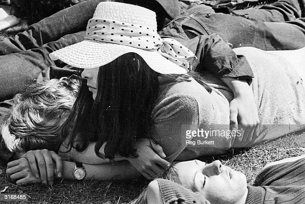 A longhaired spectator at the free Rolling Stones tribute concert to recently deceased band member Brian Jones in London's Hyde Park