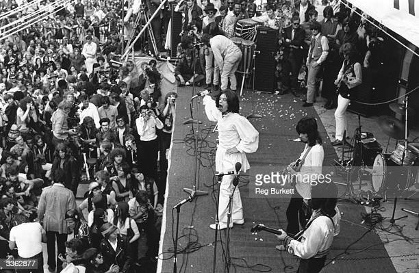 British rock singer Mick Jagger, performing with The Rolling Stones, at the free open-air concert in Hyde Park given in memory of guitarist Brian...