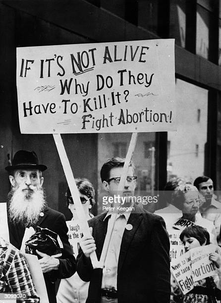 An antiabortion protestor at a demonstration in front of the American Hotel in midtown New York where the American Medical Association is holding its...