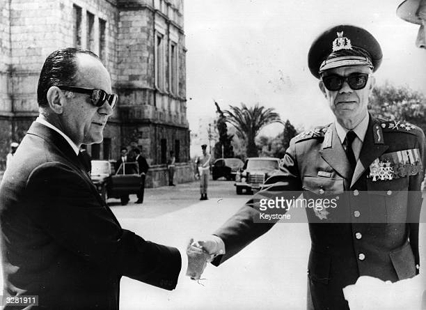 Greek premier George Papadopoulos shakes hands with Commander in Chief of the Greek Armed Forces General Odysseas Angelis