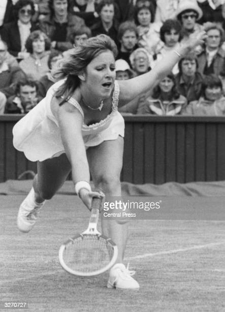 American tennis player Chris Evert stretches for a ball during her match against Virginia Wade at Wimbledon
