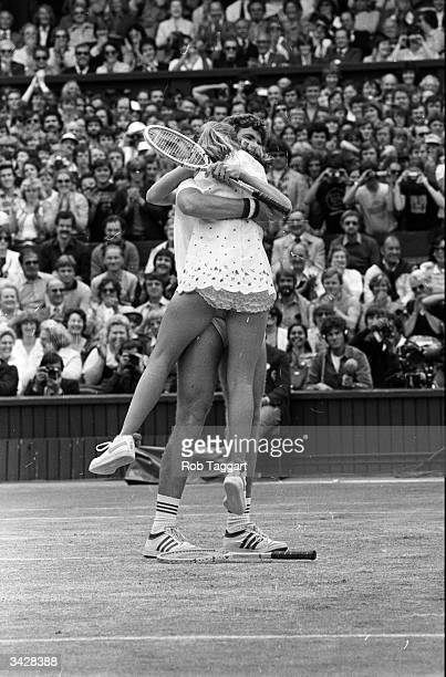 John Austin gives Tracey a big hug after they won the finals of the mixed doubles at Wimbledon