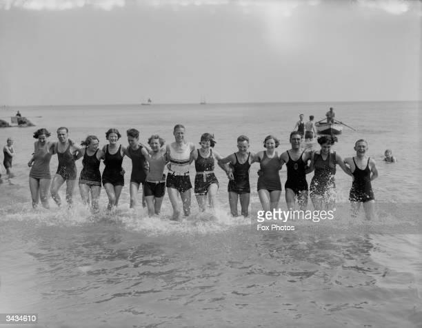 Day trippers bathing at Brighton seaside resort in East Sussex