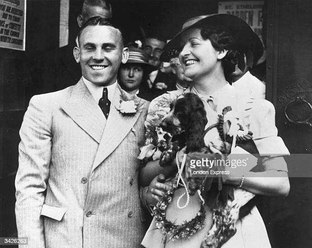 Brentford Football Club left-winger and Welsh International football player Des Hopkins and his bride Nancy Lane, with her spaniel, on their wedding...