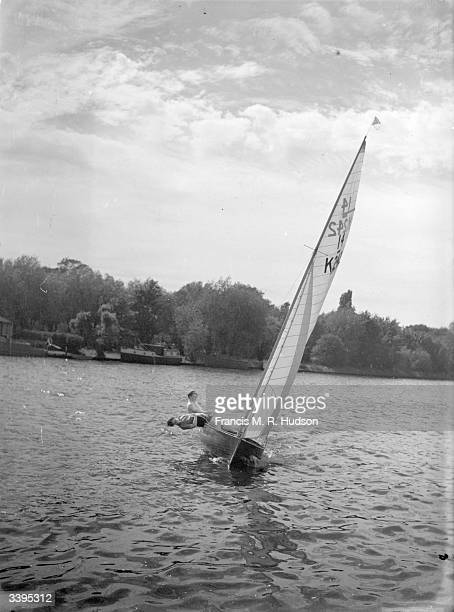 Yachting enthusiasts on the river Thames at Teddington Middlesex