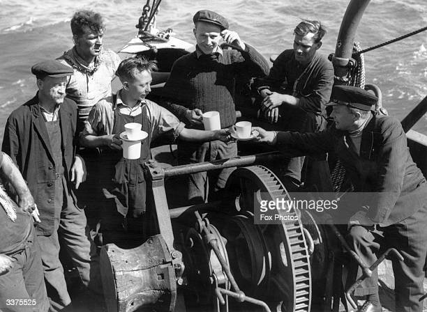 The crew of the London based tug 'Sunvill' one of the many small craft which took part in the evacuation of British and allied troops from Dunkirk.