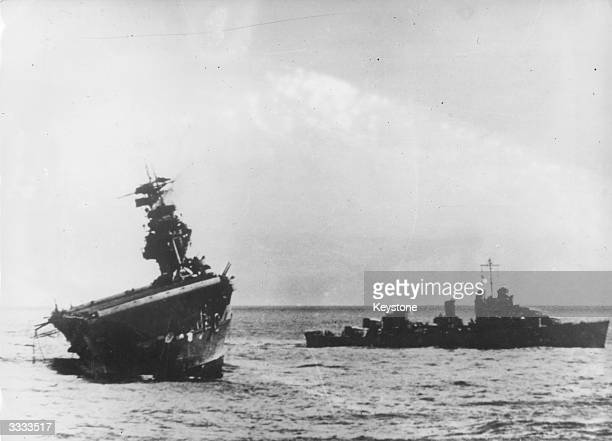 USS Yorktown listing heavily as she slowly sinks having been attacked by the Japanese near the Midway Islands