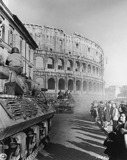 US fifth Army tanks roll past the Coliseum at the onset...