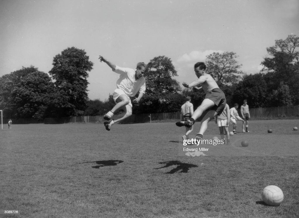 English footballers Bobby Charlton (left) and Bobby Robson training before the world Cup at Roehampton, London.