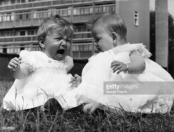 Suzanne Anderton aged 8 months and Maria Barnes aged 6 months crying even after they have just won the first heat in the baby show which is part of...