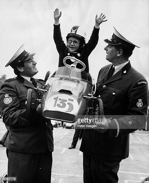 Officials of the RAC hoist aloft Andrew Coombe of Sydenham after he has won the pedalcar Junior Grand Prix at Crystal Palace motor racing circuit