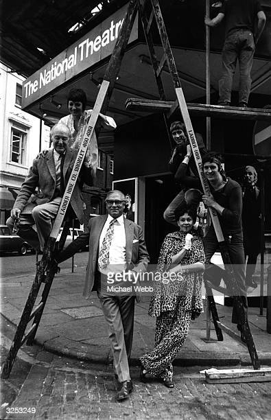The cast of Jonathan Miller's 'The Merchant of Venice' stand on a ladder outside the Cambridge Theatre Anthony Nicholls plays Antonio Jane Lapotaire...