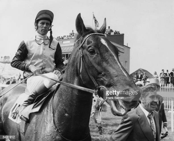 'Snow White' with his jockey Brian Taylor after winning the Derby at Epsom