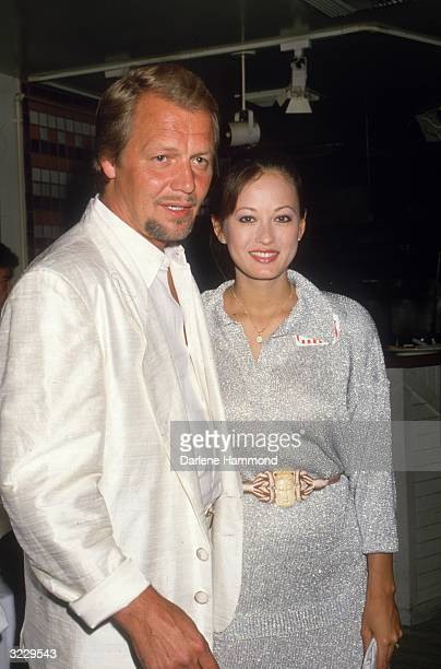 American actor David Soul and his wife Singaporeanborn actor Julia Nickson standing together at an event Soul is wearing a white silk shantung blazer...