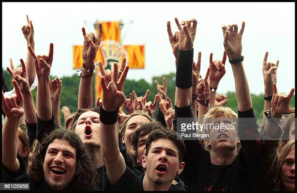 Heavy Metal Rock fans and audience hold their hands in the air at the Dynamo Rock Festival in Nijmegen Netherlands on 5th June 2004