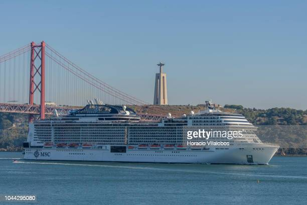 5th largest cruise ship in the world with a passenger capacity of 4500 MSC Meraviglia owned and operated by MSC Cruises sails past 25 de Abril bridge...