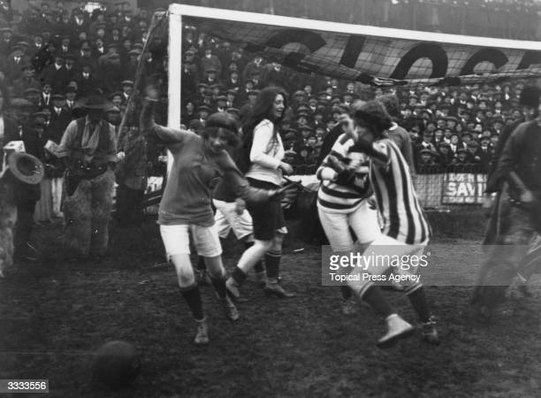 Confusion in the goal mouth during a ladies football match in 1914