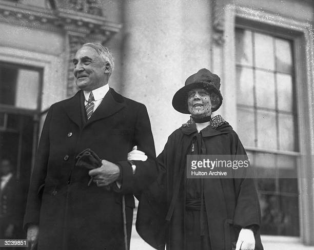 American president Warren G Harding and his wife Florence pose in front of the White House Washington DC