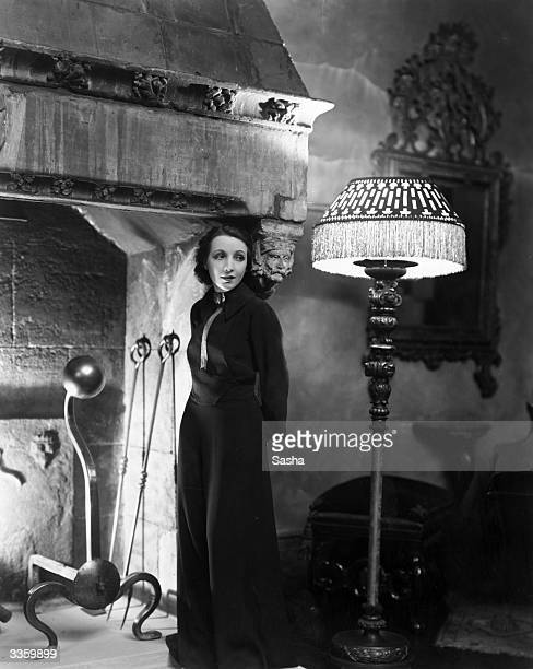 American actress Bessie Love standing by an enormous carved stone fireplace in her London home She is currently touring England with her new revue...