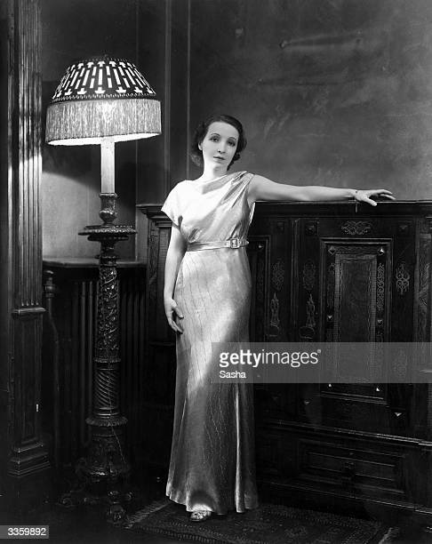 American actress Bessie Love standing in her London home She is currently touring England with her new revue 'Lucky Stars'