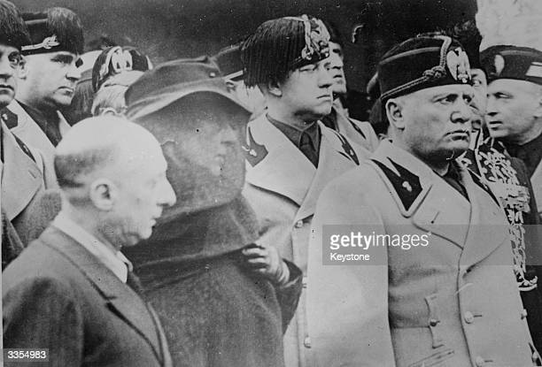 Mussolini with Count Ciano at the funeral of Gabriele D'Annunzio an Italian writer adventurer and Political leader On the left are Gabriele's eldest...