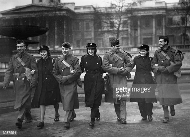 US soldiers part of a contingent who were in London seen out walking with NFS girls in Trafalgar Square