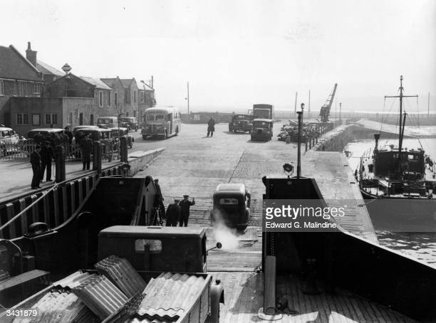 At Yarmouth, Isle of Wight traffic leaves the 'Farringford', British Railways' diesel-electric passenger and car ferry to the island.