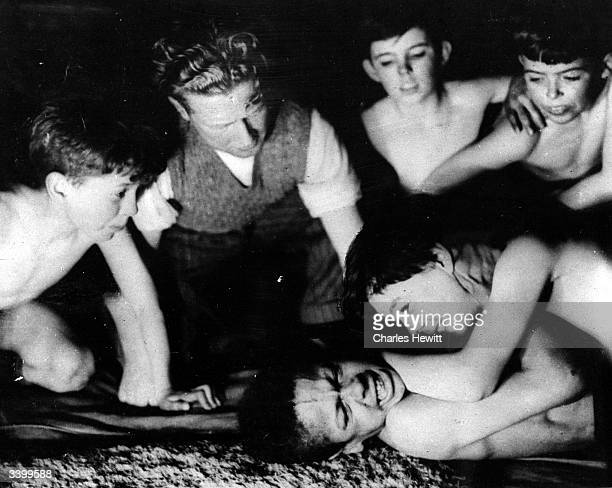 Boys wrestling on a mat at Rodney Youth Centre in a poor area of Liverpool Original Publication Picture Post 4729 The Street Corner With A Roof On...