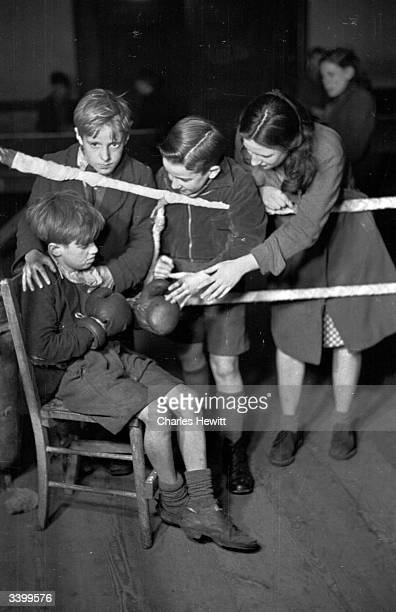 Children encouraging one of their peers at the ringside during a boxing match at Rodney Youth Centre in Liverpool Original Publication Picture Post...