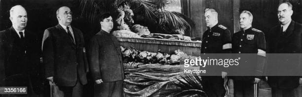 Soviet Communist leader Joseph Stalin laying in state surrounded by officials after dying suddenly
