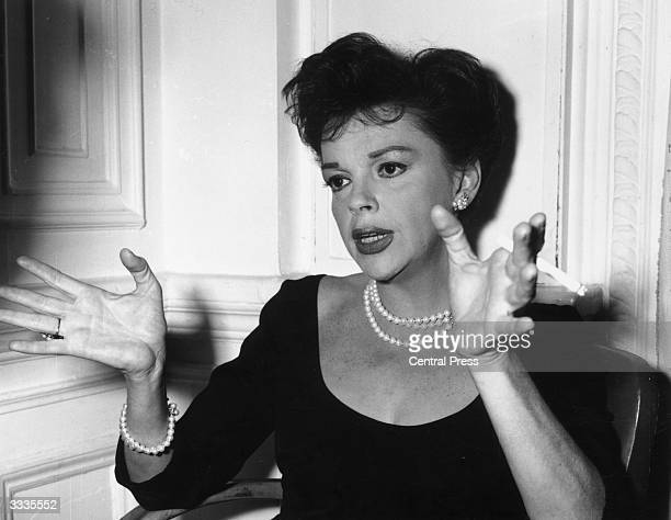 American actress Judy Garland , born Frances Gumm, during a press conference at the Savoy Hotel, London, for the film premiere of 'I Could Go On...