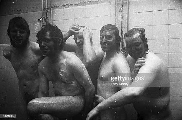Miners taking a shower after returning to work at the Coleville mine Leicester