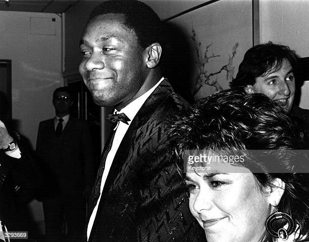 Comedian Lenny Henry with comedienne wife Dawn French looking happy at the BAFTA awards ceremony