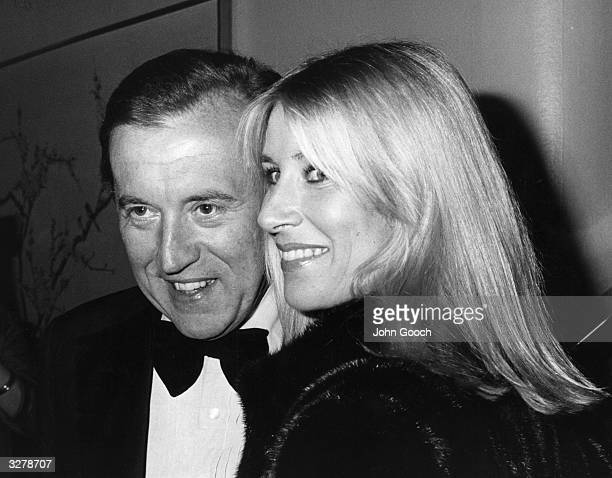 David Paradine Frost broadcaster and businessman attending the BAFTA awards with his wife Lady Karina the daughter of the Duke of Norfolk